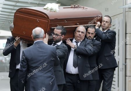 Stock Photo of The coffin of late Spanish soprano Monserrat Caballe is taken during her funeral in Barcelona, Spain, 08 October 2018. Monserrat Caballe died early 06 October 2018.