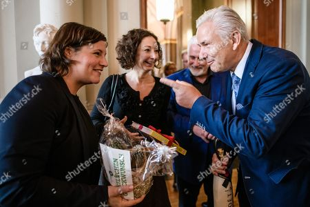 Stock Picture of Former Berlin Governing Mayor Klaus Wowereit (R) receives presents next to his life partner Joern Kubicki (3-L) from Greens party (Die Gruenen) Berlin parliamentary group co-leader Antje Kapek (L), and Mayor of Berlin and Senator for Economy, Energy and Enterprises of the Greens Party, Ramona Pop (2-L), as he arrives for a lunch on the occasion of his 65th birthday at the Berlin town hall 'Rotes Rathaus' in Berlin, Germany, 08 October 2018 Wowereit turned 65 on 01 October 2018. Berlin Governing Mayor Michael Mueller arranged a lunch on this occasion.