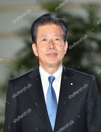 Natsuo Yamaguchi, leader of the coalition junior partner Komeito, arrives at the Prime Minister's office, as Prime Minister Shinzo Abe reshuffles his Cabinet for the start of his third three-year term.