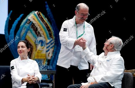 Spanish chef Juan Mari Arzak (R), his daughter Elena (L), and his work mate and relevant Spanish chef Pedro Subijana (C) take part in Arzak's homage ceremony during the opening of Gastronomika's 20th edition in San Sebastian, Spain, 8 October 2018. The gastronomical congress takes place from 7 to 10 October 2018.