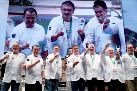 Spanish chef Juan Mari Arzak (2R), and some of his work mates and relevant Spanish chefs Carlos Arguiñano (L), Martin Berasategi (2L), Andoni Luis Aduriz (3L), Eneko Atxa (4L), Josean Allia (4R), Pedro Subijana (3L), and Hilario Arbelaitz (R), take part in Arzak's homage ceremony during the opening of Gastronomika's 20th edition in San Sebastian, Spain, 8 October 2018. The gastronomical congress takes place from 7 to 10 October 2018.