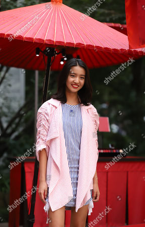 Japanese model Mitsuki Kimura 'Koki' smiles as she attends a press preview of French fashion brand Chanel's cosmetics promotional event 'Chanel Matsuri' (Chanel festival) at the Tenso shrine in Tokyo.