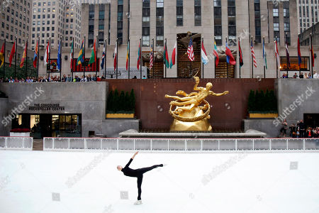 Stock Image of Five-time Finnish national champion figure skater Kiira Korpi hosts a ceremonial first skate marking the 82nd season opening of The Rink at Rockefeller Center, in New York. Korpi was joined on the most famous ice rink in the world by rising youth skaters from Ice Theatre of New York and Figure Skating in Harlem