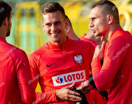 Stock Photo of Polish national soccer team players Arkadiusz Milik (C) and Artur Jedrzejczyk (R) attends a training session in Katowice, Poland, 08 Ocktober 2018. Poland will face Portugal in their UEFA Nations League soccer match on 11 October.