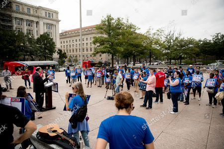 Rep. Brad Sherman, D-Calif., at left, speaks at a rally to oppose a plan by the White House's Office of Management and Budget to sell off the U.S. Postal Service to corporate interests at Freedom Plaza, in Washington