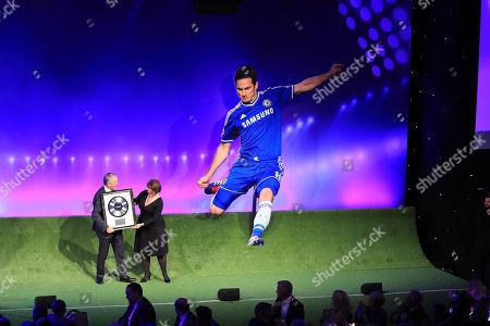Richard Scudamore receives award from Julie Wheelan (Nordoff Robbins) at the 2018 Legends of Football Award, Great Room, Grosvenor House, London
