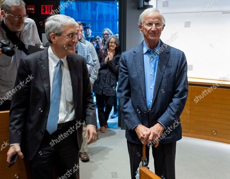 Stock Picture of Peter Salovey, President of Yale University, left, welcomes Yale University Professor William Nordhaus, one of the 2018 winners of the Nobel Prize in economics, before speaking about the honor, in New Haven, Conn. Nordhaus was named for integrating climate change into long term macroeconomic analysis