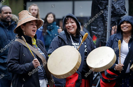 Alice Oligario, left, drums with Belinda Moreno and Sabrina Gardner, all Squamish First Nation tribal members, during an Indigenous Peoples Day blessing and rally before a march, in Seattle. In 2014, the Seattle City Council voted to stop recognizing Columbus Day and instead turned the second Monday in October into a day of recognition of Native American cultures and peoples