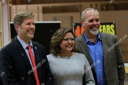 Albuquerque Mayor Tim Keller, from left, Gov. Susana Martinez and Netflix vice president for physical production Ty Warren pose for a photograph following a news conference at ABQ Studios in Albuquerque, N.M., on . Netflix announced that it had chosen Albuquerque as its new production hub and it was in the process of buying an existing studio complex that includes several sound stages, offices and a back lot