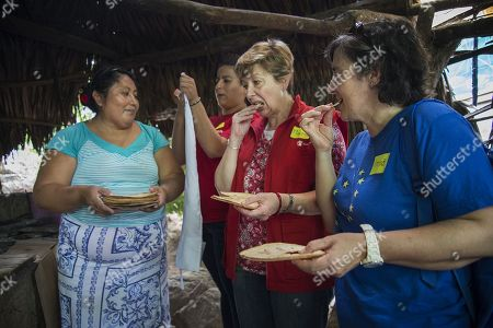 Oaxacan Luisa Villaseca (L) offers food to Maria Josefina (C) of Save the Children Mexico and to Imma Roca (R), deputy head of the delegation of the European Union (EU) in Mexico, during a visit to the town of San Perdo Huilotepec, in the state of Oaxaca, Mexico, 08 October 2018. A delegation from the European Union (EU) along with Save the Children Mexico visited the southern Mexican state of Oaxaca, where the community block is promoting a project to reactivate the economy of the area and help families affected by the two strong earthquakes of September 2017.