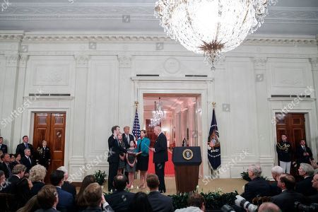 Supreme Court Associate Justice Brett Kavanaugh (L), with his wife Ashley Kavanaugh (2-R), Daughters Liza and Margaret Kavanaugh and US President Donald J. Trump (2-L), is ceremonially sworn in by Supreme Court Associate Justice Anthony Kennedy (R) in the East Room of the White House in Washington, DC, USA, 08 October 2018. Justice Kavanaugh was sworn in as the 114th Justice of the Supreme Court on the evening of 06 October.