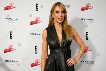 "Colombian Alejandra Azcarate, host of the reality show ""¿Hay que ver para querer?,"" or ""Does one need to see to believe?,"" poses for a portrait in Mexico City. The reality show has single women choose suitors without seeing their faces first, and premieres on Oct. 8, 2018 on E! Entertainment Television"