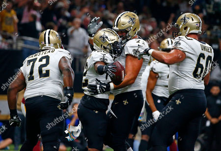New Orleans Saints running back Mark Ingram, second left, celebrates his touchdown carry with offensive tackle Ryan Ramczyk, offensive tackle Terron Armstead (72) and center Max Unger (60) in the first half of an NFL football game against the Washington Redskins in New Orleans