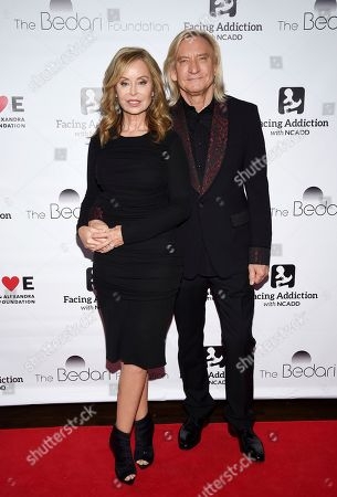 Marjorie Bach Walsh, Joe Walsh. Honorees Marjorie Bach Walsh and husband Joe Walsh pose together at the Facing Addiction with NCADD (National Council on Alcoholism and Drug Dependence) gala at the Rainbow Room, in New York