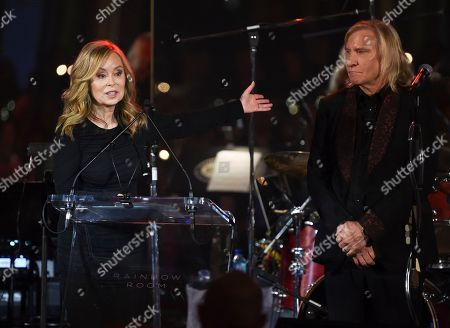 Marjorie Bach Walsh, Joe Walsh. Honorees Marjorie Bach Walsh, left, and Joe Walsh speak at the Facing Addiction with NCADD (National Council on Alcoholism and Drug Dependence) gala at the Rainbow Room, in New York