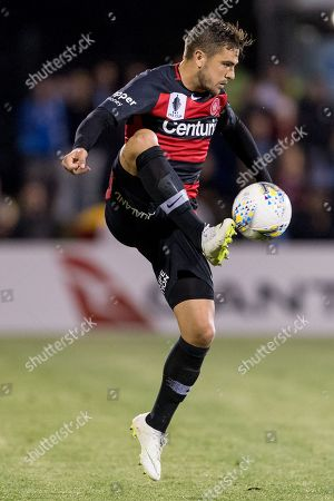 Western Sydney Wanderers defender Josh Risdon (4) controls the ball at the FFA Cup semi-final soccer match between Western Sydney Wanderers FC and Sydney FC at Panthers Stadium in Sydney.