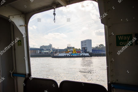 The Ernest Bevin Woolwich Ferry is seen on the River Thames through a window onboard the James Newman ferry on the final day of operation with the old boats.  The Woolwich ferry river crossing service closes from Saturday 6th October until the end of the year to allow new pontoons to be constructed for new boats and the ferry is planned to resume at the end of the year.