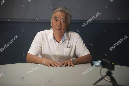 Stock Image of Denis Akiyama as Koji Yasuda