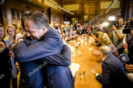 Stock Photo of Dutch Democrats 66 (D66) party leader Alexander Pechtold hugs his successor Rob Jetten during his last day in the Senate, in The Hague, The Netherlands, 09 October 2018. Pechtold announced on 06 October, his resignation as D66 leader and from the parliament.