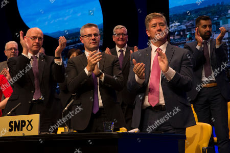 Members of the Scottish cabinet applaud at the end of the keynote speech to conference by Nicola Sturgeon, First Minister of Scotland and Leader of the Scottish National Party (SNP) - Michael Russell, Cabinet Secretary for Government Business and Constitutional Relations or 'Brexit Minister', John Swinney, Deputy First Minister and Cabinet Secretary for Education and Skills, Derek Mackay, Cabinet Secretary for Finance, Economy and Fair Work, Fergus Ewing, Cabinet Secretary for Rural Economy, Keith Brown, Cabinet Secretary for Economy, Jobs and Fair Work, and Depute Leader of the Scottish National Party (SNP), and Humza Yousaf, Cabinet Secretary for Justice
