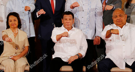 Rodrigo Duterte, Gloria Macapagal Arroyo, Salvador Medialdea. Philippine President Rodrigo Duterte gestures with a fist bump after addressing congressmen and Government officials at the presentation of Republic Act bills ceremony at the Presidential Palace in Manila, Philippines, . Philippine officials say President Rodrigo Duterte has told his Cabinet that medical tests show he doesn't have cancer, but he won't be releasing a public report on his health. At left is former President and now House Speaker Gloria Macapagal Arroyo and at right is Executive Secretary Salvador Medialdea