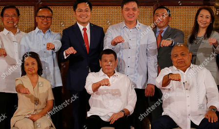 Rodrigo Duterte, Gloria Macapagal Arroyo, Salvador Medialdea. Philippine President Rodrigo Duterte, seated center, gestures with a fist bump as he poses with congressmen and government officials at the presentation of Republic Act bills ceremony at the Presidential Palace in Manila, Philippines . Philippine officials say President Rodrigo Duterte has told his Cabinet that medical tests show he doesn't have cancer, but he won't be releasing a public report on his health. Seated at left is former President and now House Speaker Gloria Macapagal Arroyo and at right is Executive Secretary Salvador Medialdea