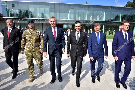 Slovenian Prime Minister Marjan Sarec (3-R) walks with NATO General Secretary Jens Stoltenberg (3-L), the Permanent Representative Slovenia in NATO Jelko Kacin (L), Minister of Defence Karl Erjavec (2-R), Minister of Foreign Affairs Miro Cerar (R), as they arrive for the presentation of a military exercise within their meeting in Brdo pri Kranju, Slovenia, 09 October 2018. The secretary General of the North Atlantic Treaty Organization (NATO) is on a one-day visit to Slovenia.