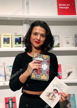 French-Georgian pianist Khatia Buniatishvili poses during the press tour presentation of the Guest of Honour Georgia of the book fair 'Frankfurter Buchmesse 2018' in Frankfurt Main, Germany, 09 October 2018. The 70th edition of the international Frankfurt Book Fair, described as the 'world's most important fair for the print and digital content business' runs from 10 to 14 October 2018 and gathers authors, writers and celebrities from all over the world. This year's Guest of Honour country is Georgia.