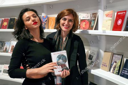 (L-R) French-Georgian pianist Khatia Buniatishvili and Medea Metreveli, Director of the Georgian National Book Center pose during the press tour presentation of the Guest of Honour Georgia of the book fair 'Frankfurter Buchmesse 2018' in Frankfurt Main, Germany, 09 October 2018. The 70th edition of the international Frankfurt Book Fair, described as the 'world's most important fair for the print and digital content business' runs from 10 to 14 October 2018 and gathers authors, writers and celebrities from all over the world. This year's Guest of Honour country is Georgia.