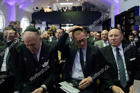 Stock Picture of Berlin Governing Mayor Michael Mueller adjusts his Jewish kippa skullcap next to the President of the World Jewish Congress Ronald Lauder (L) prior the rabbinical ordination ceremony of three rabbis and three cantors at the Beth Zion Synagogue in Berlin, Germany, 09 October 2018. The three Ukrainian-born rabbis are the first Orthodox rabbis to be ordained in Berlin since World War II.
