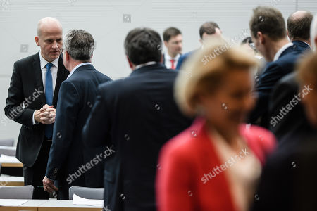 The newly elected chairman of the Christian Democratic Union (CDU) and Christian Social Union (CSU) parliamentary group Ralph Brinkhaus (L) and former German Interior Minister Thomas de Maiziere (2-L) talk at the beginning of a faction meeting at the German 'Bundestag' parliament in Berlin, Germany, 09 October 2018. The parties faction discussed, among other topics, the coming state elections in Bavaria.