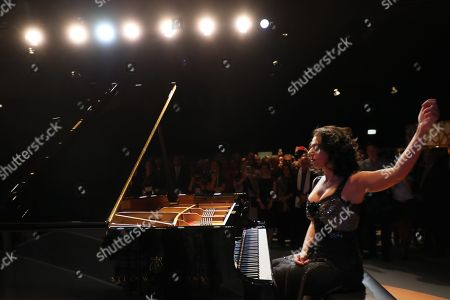Stock Photo of French-Georgian pianist Khatia Buniatishvili performs during the opening ceremony at the book fair 'Frankfurter Buchmesse 2018', in Frankfurt am Main, Germany, 09 October 2018. The 70th edition of the international Frankfurt Book Fair, described as the 'world's most important fair for the print and digital content business' runs from 10 to 14 October and gathers authors, writers and celebrities from all over the world. This year's Guest of Honour country is Georgia.