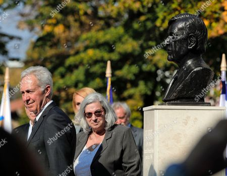 U.S. Ambassador Hans G. Klemm, left, and Israeli Ambassador Tamar Samash stand next to the bust of Nobel laureate Elie Wiesel, in Bucharest, Romania, . Romanian officials joined by ambassadors have unveiled a bust of late Nobel laureate Elie Wiesel to mark Romania's National Holocaust Day in a small square named after Wiesel in the capital