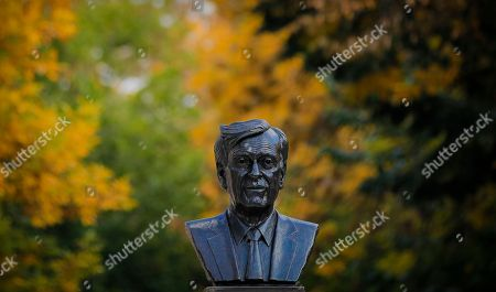 A bust of Nobel laureate Elie Wiesel is backdropped by autumn foliage in Bucharest, Romania, . A bust of Romanian-born writer Elie Wiesel has been unveiled in Bucharest on the country's national Holocaust remembrance day. The director of Romania's National Institute for the Study of the Holocaust joined Bucharest's mayor and the U.S. and Israeli ambassadors on Tuesday for the event in a small square named after Wiesel in the capital