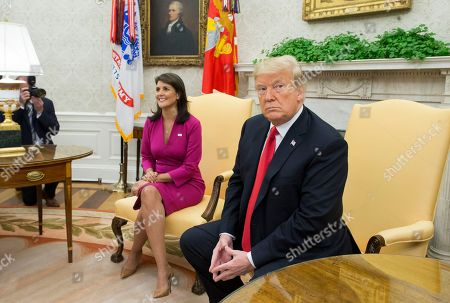 US Ambassador to the United Nations Nikki Haley (L) and US President Donald Trump (R) sit beside one another moments before delivering remarks to members of the news media in the Oval Office of the White House in Washington, DC, USA, 09 October 2018. Trump and Haley announced that Haley will leave her position at the end of the year.