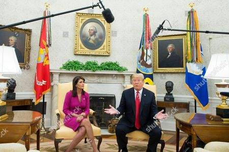 US Ambassador to the United Nations Nikki Haley (L) listens to US President Donald Trump (R) deliver remarks to members of the news media in the Oval Office of the White House in Washington, DC, USA, 09 October 2018. Trump and Haley announced that Haley will leave her position at the end of the year.