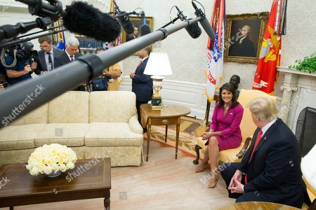 US Ambassador to the United Nations Nikki Haley (L) and US President Donald Trump (R) deliver remarks to members of the news media in the Oval Office of the White House in Washington, DC, USA, 09 October 2018. Trump and Haley announced that Haley will leave her position at the end of the year.