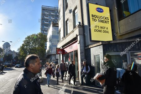 Stock Image of Notting Hill Gate. Millionaire owner of Pimlico Plumbers Charlie Mullins starts a 'Bollocks to Brexit' poster campaign across London.