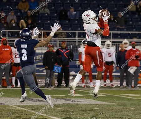 Mike Bell, Kaleb Fossum. Fresno State defensive back Mike Bell (4) jumps in front of Nevada's wide receiver Kaleb Fossum (3) and makes an interception in the first half of an NCAA college football game in Reno, Nev