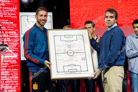 Spanish defender and captain of the Spanish national soccer team Sergio Ramos (L) hands out the game strategic board of the UEFA Euro 2008 final match to Spanish national soccer team head coach and former soccer player Luis Aragones' son Luis Aragones (R) during a tribute for Aragones at Las Rozas sports facilities in Madrid, Spain, 09 October 2018. The homage featured the presentation of the documentary 'Luis, the wise man of success' on life and achievements of Luis Aragones.