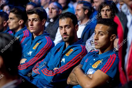 Stock Picture of (L-R) Spanish soccer players Kepa Arrizabalaga, Sergio Busquets, and Thiago Alcantara attend a tribute for late Spanish national soccer team head coach and former soccer player Luis Aragones at Las Rozas sports facilities in Madrid, Spain, 09 October 2018. The homage featured the presentation of the documentary 'Luis, the wise man of success' on life and achievements of Luis Aragones.