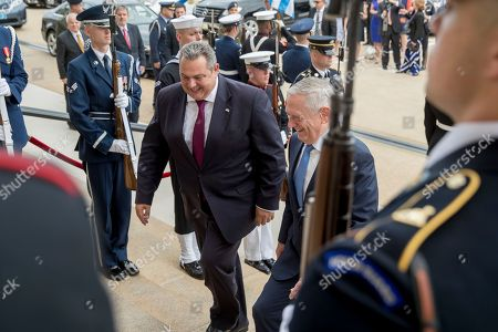 Jim Mattis, Panagiotis Kammenos. Defense Secretary Jim Mattis, right, greets Greek Defense Minister Panagiotis Kammenos, center, during an enhanced honor cordon at the Pentagon, in Washington