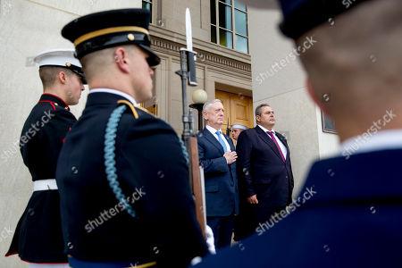 Jim Mattis, Panagiotis Kammenos. Defense Secretary Jim Mattis, second from right, and Greek Defense Minister Panagiotis Kammenos, right, stand as national anthems are played during an enhanced honor cordon at the Pentagon, in Washington
