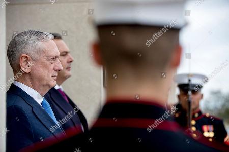 Jim Mattis, Panagiotis Kammenos. Defense Secretary Jim Mattis, left, and Greek Defense Minister Panagiotis Kammenos, second from left, stand as national anthems are played during an enhanced honor cordon at the Pentagon, in Washington