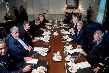 Jim Mattis, Panagiotis Kammenos. Defense Secretary Jim Mattis, third from right, and Greek Defense Minister Panagiotis Kammenos, third from left, attend a meeting at the Pentagon, in Washington