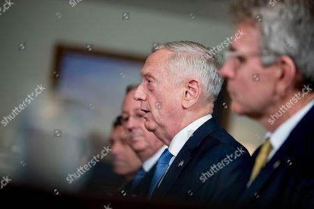Defense Secretary Jim Mattis speaks to Greek Defense Minister Panagiotis Kammenos, during a meeting at the Pentagon, in Washington