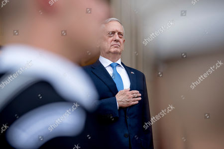 Defense Secretary Jim Mattis, pictured, stands with Greek Defense Minister Panagiotis Kammenos as national anthems are played during an enhanced honor cordon at the Pentagon, in Washington
