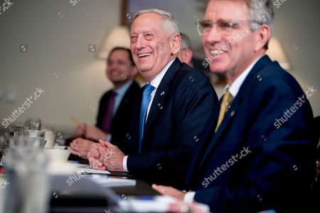 Stock Picture of Defense Secretary Jim Mattis, left, speaks to reporters during a meeting with Greek Defense Minister Panagiotis Kammenos at the Pentagon, in Washington