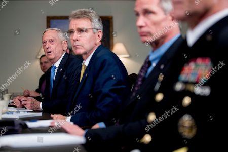 Defense Secretary Jim Mattis, left, speaks to reporters during a meeting with Greek Defense Minister Panagiotis Kammenos at the Pentagon, in Washington
