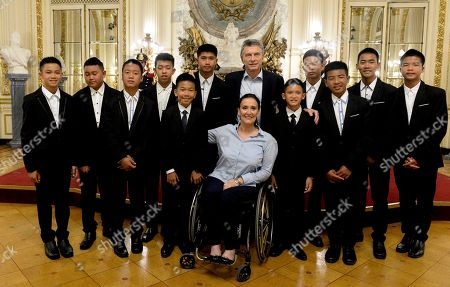 Mauricio Macri, Gabriela Michetti. In this handout picture released by the Office of the President of Argentina, members of the Thai team Wild Boars pose for photos with Argentina President Mauricio Macri and Vice President Gabriela Michetti, at the government house in Buenos Aires, Argentina